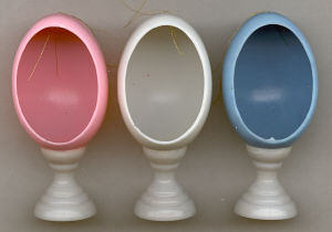 Egg in Holder - Plastic - 3-1/2 inch tall - 12 Pieces - Assorted colors.